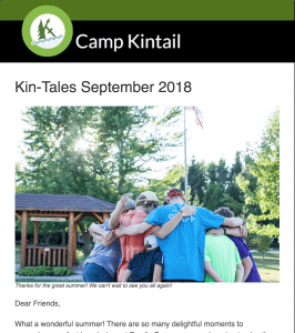 Title text: Kin-Tales September 2018. Image: Staff and campers huddling in a circle.