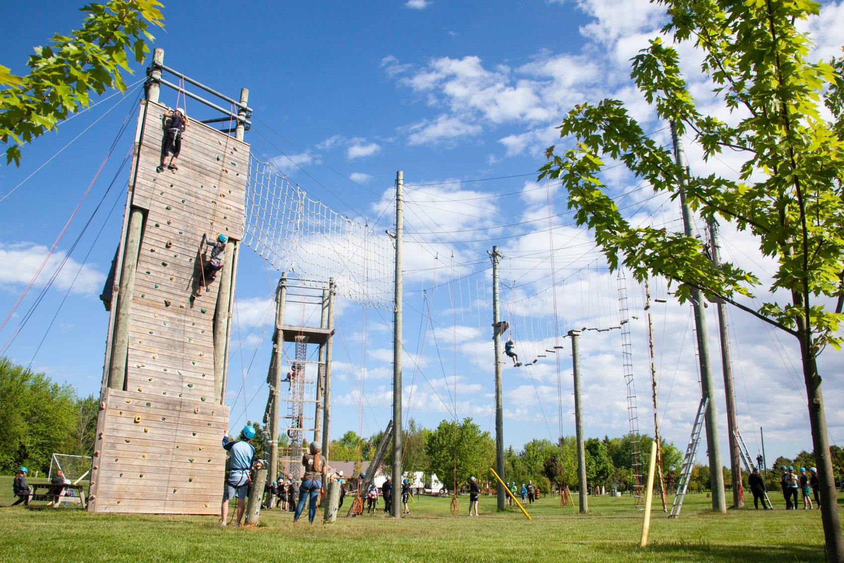 A scenic view is captured showing the high ropes course at summer camp.