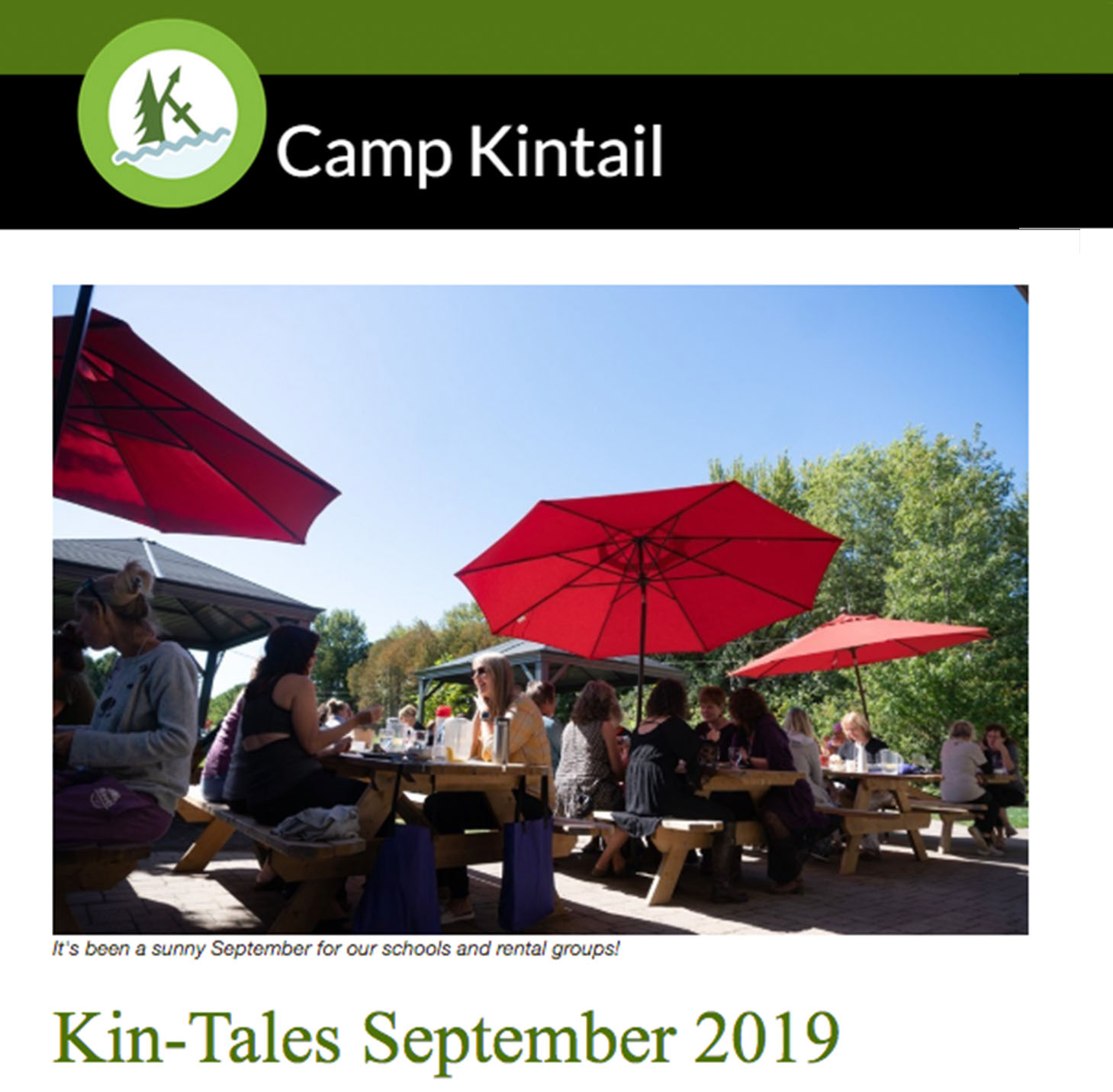 Title text: Kin-Tales September 2019. Image: Red umbrellas on picnic tables.