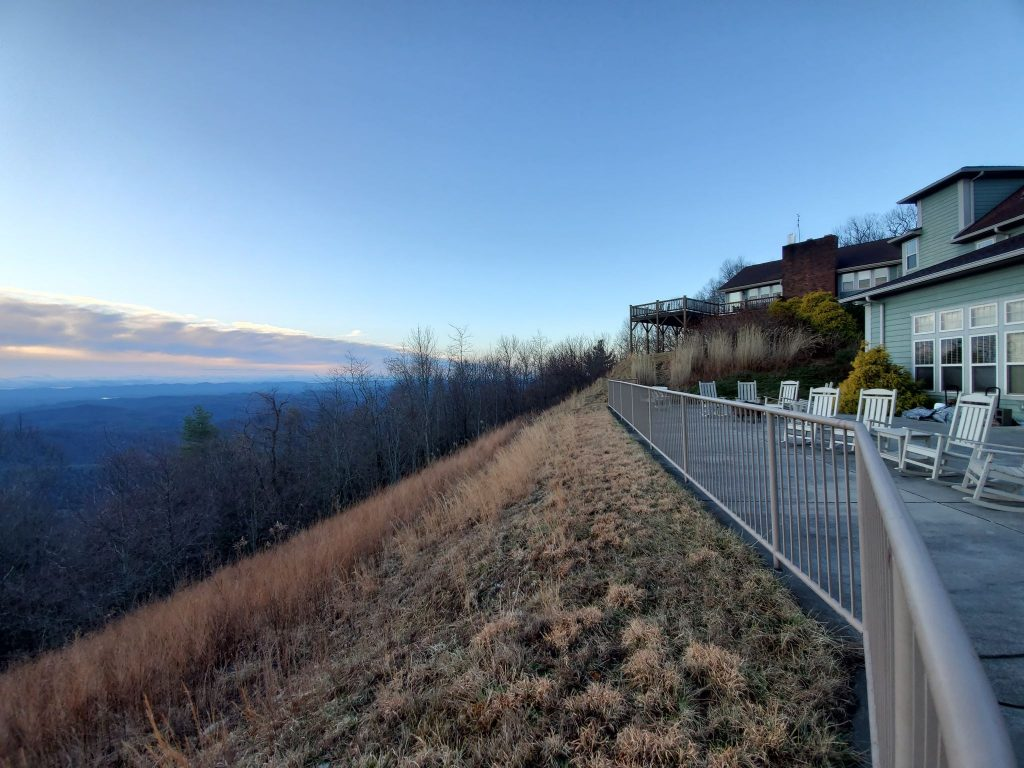 A scenic view of a deck that overlooks the mountains at Laurel Ridge.