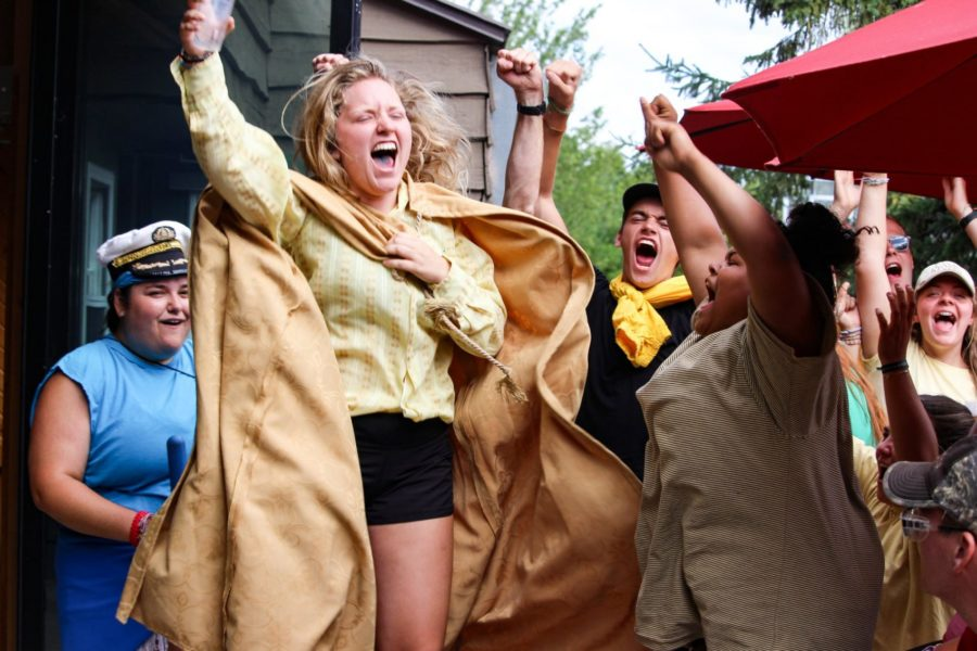 Staff members dressed in fun costumes cheers, chant, and scream enthusiastically at summer camp!
