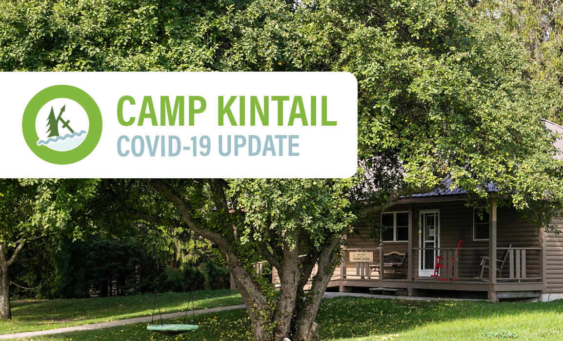 """A scenic view of the front of Feathers Cottage with a large crabapple tree on the front lawn. Text on it reads, """"Camp Kintail COVID-19 Update""""."""