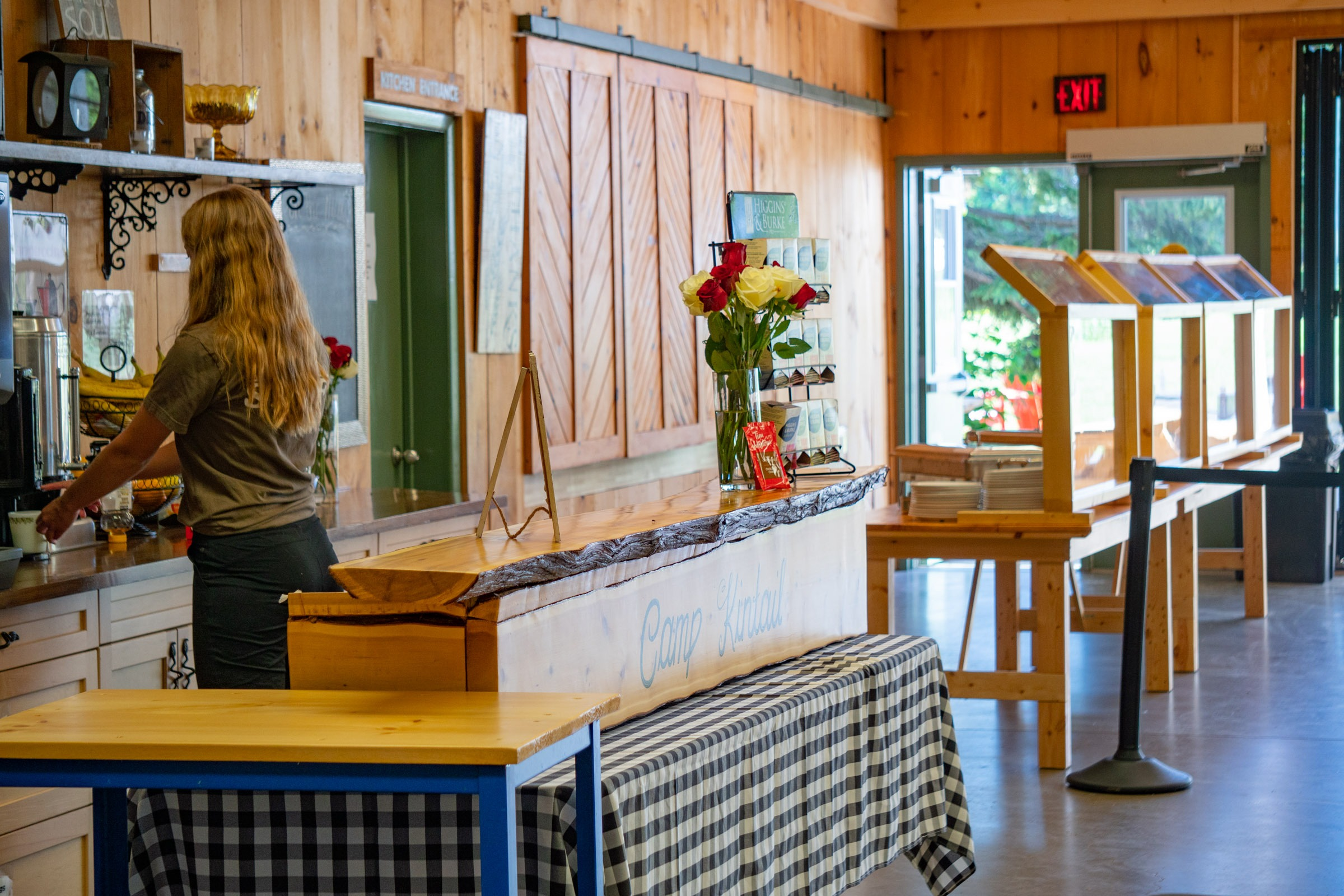 A staff member named Piglet prepares a coffee at the hospitality beverage station inside MacDonald Lodge dining hall.