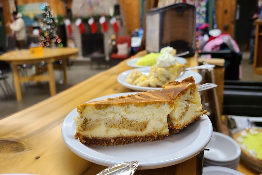 A close up of pumpkin swirl cheesecake on a white plate set up on the hospitality bar at Camp Kintail.
