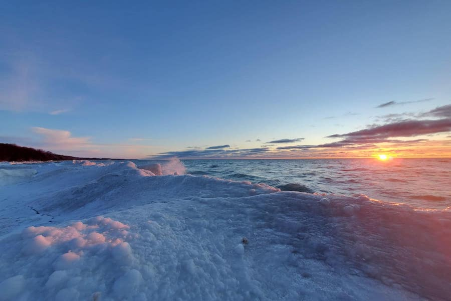 A scenic winter view of ice and snow covering the shore on Lake Huron.