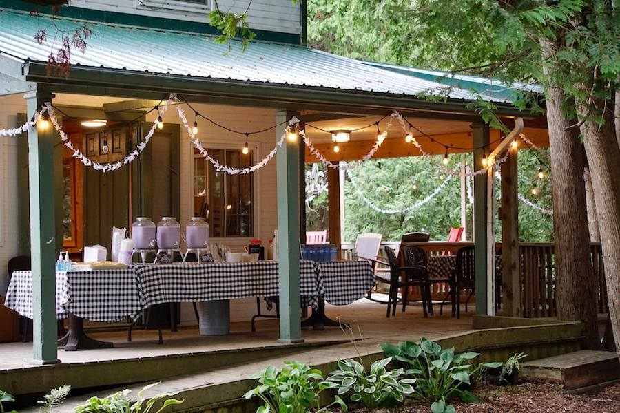 Covered outdoor deck with buffet table at Harmony House.