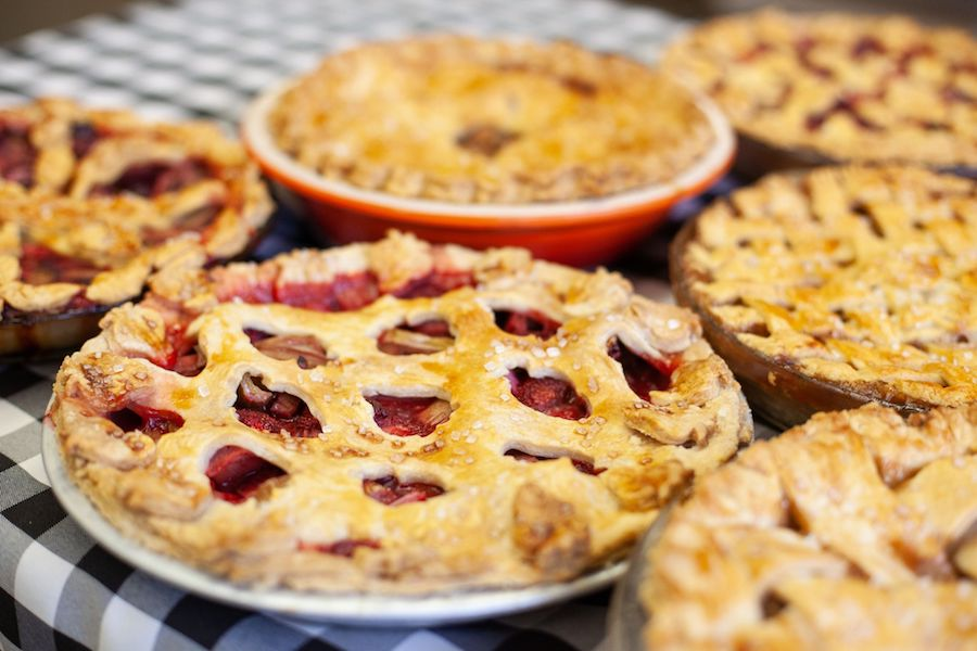 Fresh homemade pies are displayed on the kitchen counter.
