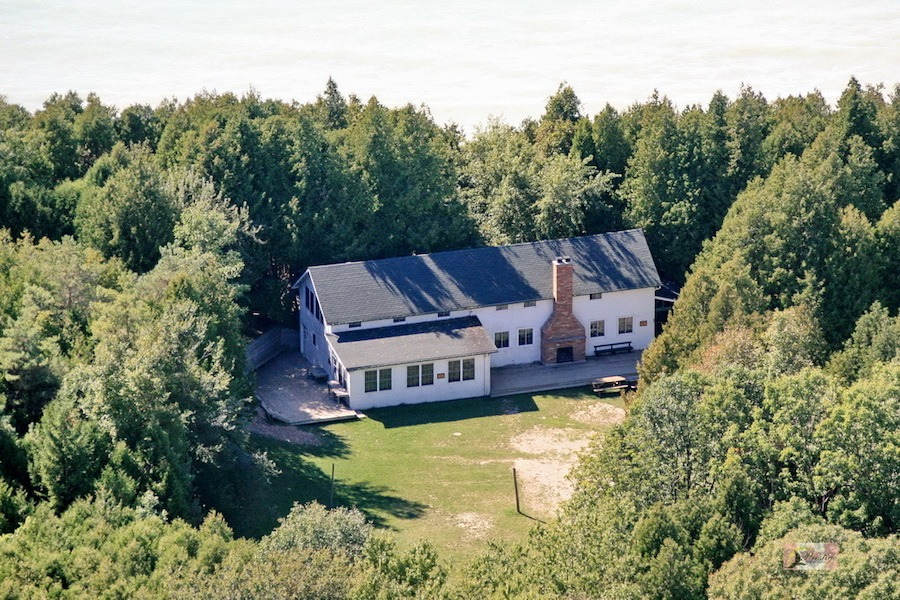 Arial view of Harmony House surrounded by cedar trees.