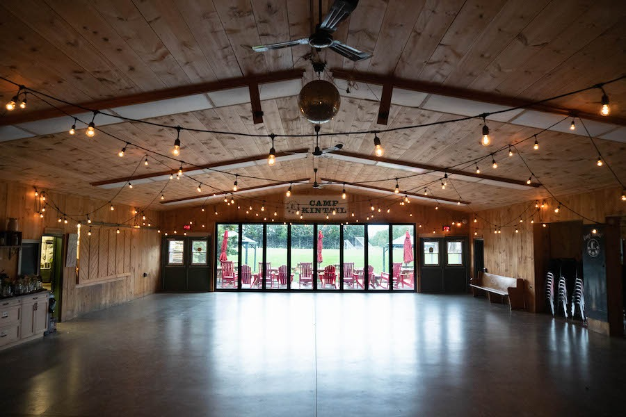 Indoor view of MacDonald Lodge dining hall with Edison lights set up.