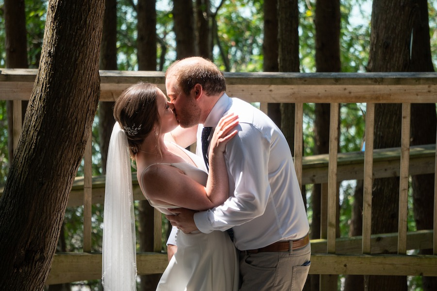 Laura and Alex share a romantic kiss in the outdoor Chapel.